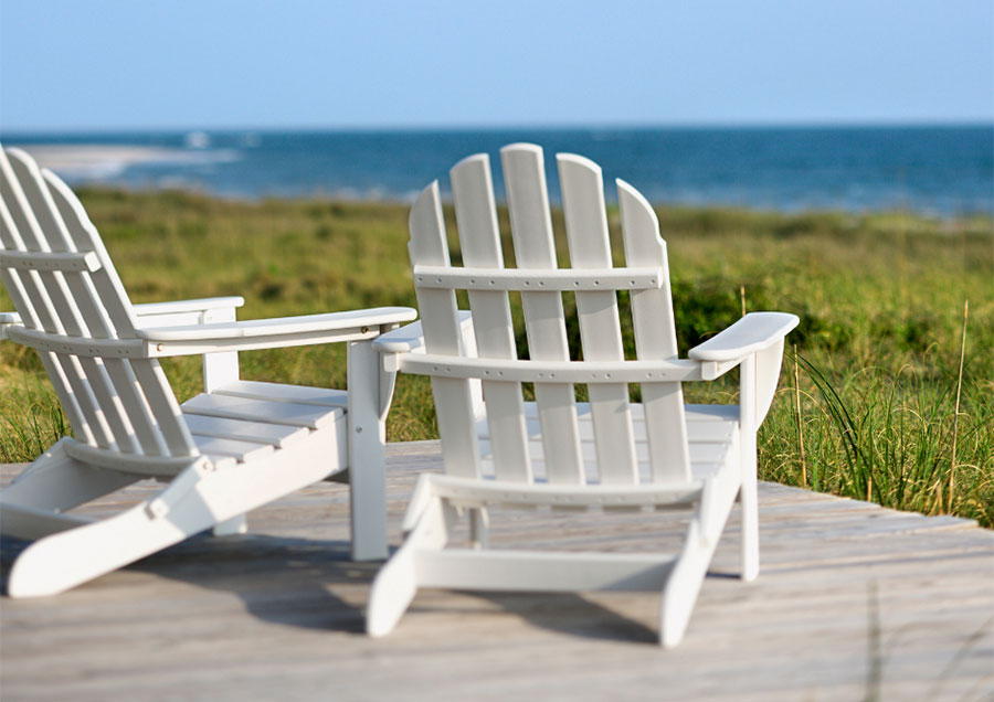 Adirondack chair on a coastal decorated porch